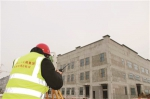 测量人员正在对运用库做封顶后整体测量。 苑激刚 摄 - 新浪吉林